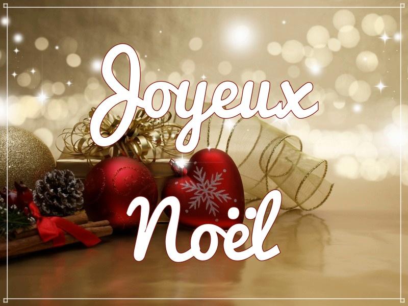 Joyeux Noël - boules, pommes de pins et lumière